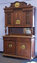 Continental carved oak 2 pc breakfront, top section with 2 glazed doors over an alcove with beveled mirror, base with 2 drawers over...