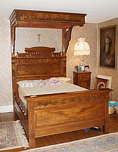 Carved Walnut Victorian half canopy bed in the Eastlake style, tufted upholstered underside of canopy, overall 98-1/4