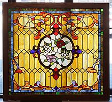 Oak framed stained glass panel with floral border in center, 61