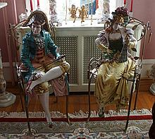 Pair of Italian ceramic figurines, seated dandy with baton, and a lady with fan, accompanied by 2 wrought iron garden chairs with le...