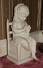 Carved Alabaster sculpture of a child sitting in a chair, 25