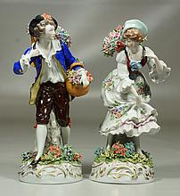 Pair of Continental porcelain figures of a man and woman with floral baskets, mark to base, approx 9
