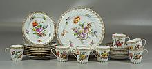 Dresden porcelain dessert set to include 7 cups and saucers, 8 dessert plates, and 2 serving plates, all fluted and floral decorated...
