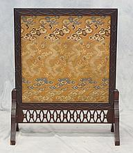 Carved teak Chinese fire screen, dragon pursuing pearl embroidered panel, 29 1/2