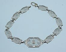 10K WG filigree bracelet w/crystal & diamond center, 4.0 dwt