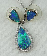 14K WG pendant set with pear-shaped black opal (fractured), 15 x 9