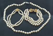(2) pearl bracelets w/14K YG catches: 2 rows of 4mm pearls and 3 rows of 5