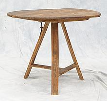 Pine and Fruitwood tilt-top tripod table, 18th century, the circular top raised on three slat-molded legs joined by a T-stretcher, 3...
