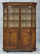 Dutch Pine and Oak side cabinet, 18th century, the upper section with a flat molded cornice above a pair of glazed doors with canted...