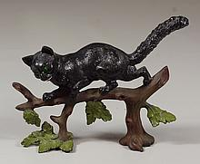 Painted cast iron cat doorstop, 9
