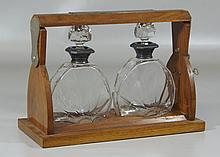 Tantalus set, oak case, two crystal bottles, silver mounted, presentation plaque to top, 10-1/2