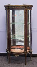 French curio cabinet with bowed glass ends and door, mirror back, glass shelves, bronze mounts, 55