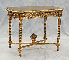 Carved and gilt Louis XVI style center table, scalloped cross stretcher base with floral basket finial, pierce carved apron all arou...