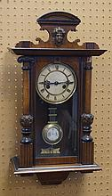 Ebonized Walnut Spring Driven Vienna Regulator with ladies head crest, 27