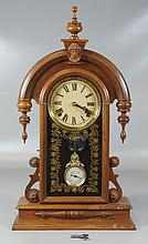 Walnut Victorian Shelf Clock with Ansonia head crest, 24