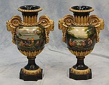 Pr Continental composition urns with HP landscape decoration, gilt rams heads handles and acanthus decoration, 27 1/2
