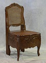 French Walnut Commode Chair, 19th/20th c, With A Carved Frame With Inset Cane Back Support and Seat, Height: 36