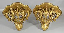 Pair of Italian carved and gilt wood wall brackets with cherubs and floral garlands, 14-3/4