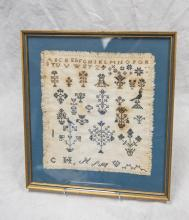 Needlework alphabet sampler, rows of flower & bird motifs, bottom row initialed CH *PM with heart, fringed border, undated, approx 1...