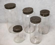 (5) Various sized apothecary Jars with tin lids, tallest 12-1/2
