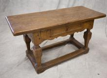 Oak tavern table, 2-board top with dovetailed cleats over apron with single drawer, raised on shaped square legs joined by flat stre...