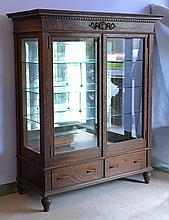 Oak Victorian 2-door rectangular display cabinet, mirror back, 3 glass shelves, 2 drawers in base, turned legs, applied ribbon & she...