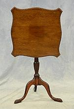 Carved mahogany George III tilt top table, square gadrooned edge serpentine top, acanthus carved urn turned stem on acanthus carved ...