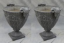Pair of lead garden urns with rams head handles, 29