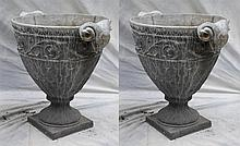 Pair of lead garden urns with rams head handles, handles repaired, 27