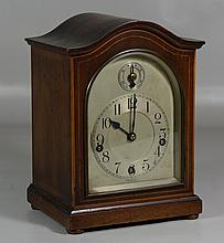 German arched top mantle clock, mahogany case, silvered dial, case with line inlay, 10-3/4