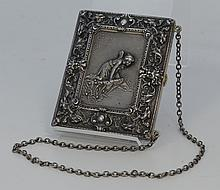 Victorian sterling silver hinged purse, gargoyle and northwind mask border, centering a winged nymph over a pool on one side, the ot...