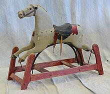 Carved and painted Wood Gliding Horse on platform base, losses to mane, ears, and bridle, gray paint and red frame, 40