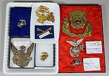 10 Military Pieces, to include: pith helmet eagle plate, circa 1880, USMC epaulet pin, circa 1885, USMC WWII pin, Custer-period calv...