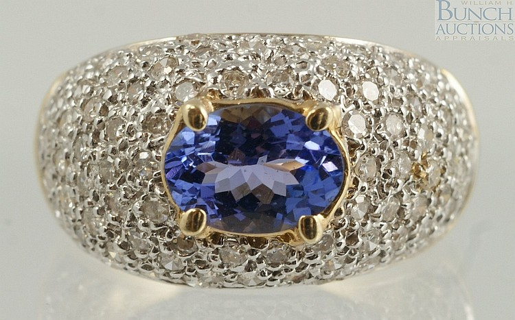 14K YG tanzanite & diamond ring, 7 x 5mm stone, with pave set top, size 5 1/2, 3.0 dwt