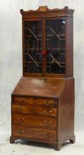 Diminutive Georgian mahogany secretary bookcase, original pulls, upper glazed door bookcase section with swag shaped cornice centeri...