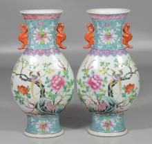 Pair of Chinese Famille Rose decorated porcelain vases with exotic birds and floral landscape, double bat handles, impressed China m...