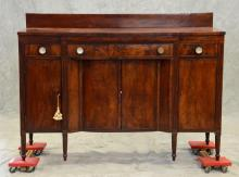 Mahogany Sheraton sideboard, rectangular top with stepped out center, over an apron with 3 drawers, original Sandwich glass and bras...