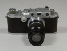 Leica IIIa 35 mm viewfinder camera, SN 203781, c 1936, 90mm Ernst Leitz Wetzlar Lens, SN 165470, with a plastic Leica lens case