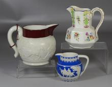 Three English pitchers to include a Davenport pitcher with hunt scene with hairline to rim, a small Copeland Staffordshire blue deco...