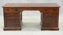 Mahogany Victorian 3-part kneehole desk, solid molded top over an apron with 2 drawers, 2-stacks each with 4 graduated drawers, c 18...