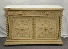 Carved oak white marble top sideboard with worn gilt and limed finish, lion head and foliate carving, barley twist columns, bun feet...