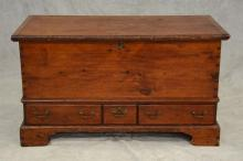 Three drawer Chippendale pine blanket chest, lift lid with molded bread board ends, lower case with 3 overlapping drawers all raised...