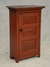 Pine one door hanging cupboard with black and red painted finish, the interior with 2 drawers, 43-1/2