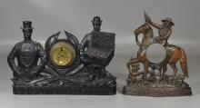 2 Cast iron figural advertising clock frames, lacking movements: The Boston Cigar/The Peg-top Cigars/LOP Growth & Company, (Montreal...
