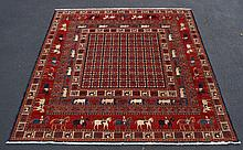 Persian Pictorial Carpet, 3 borders with stylized animals, with 81 block center field, minor wear in several areas, otherwise in goo...