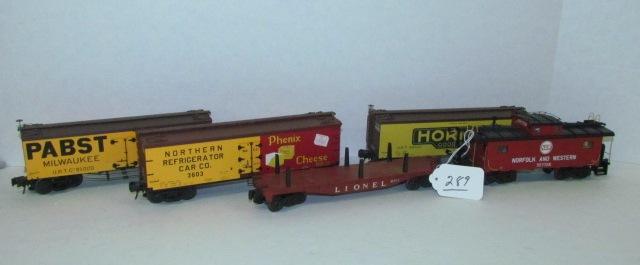 Five O-gauge Train Cars
