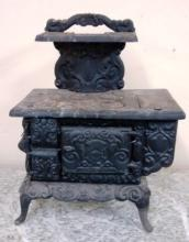 Early working Child's Cast Iron Cook Stove