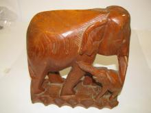 Vintage carved wood mother and baby elephant on box