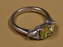 A yellow diamond ring - certified - in 18 carat gold