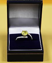 A 1.61 carat yellow diamond ring set in 18ct white gold